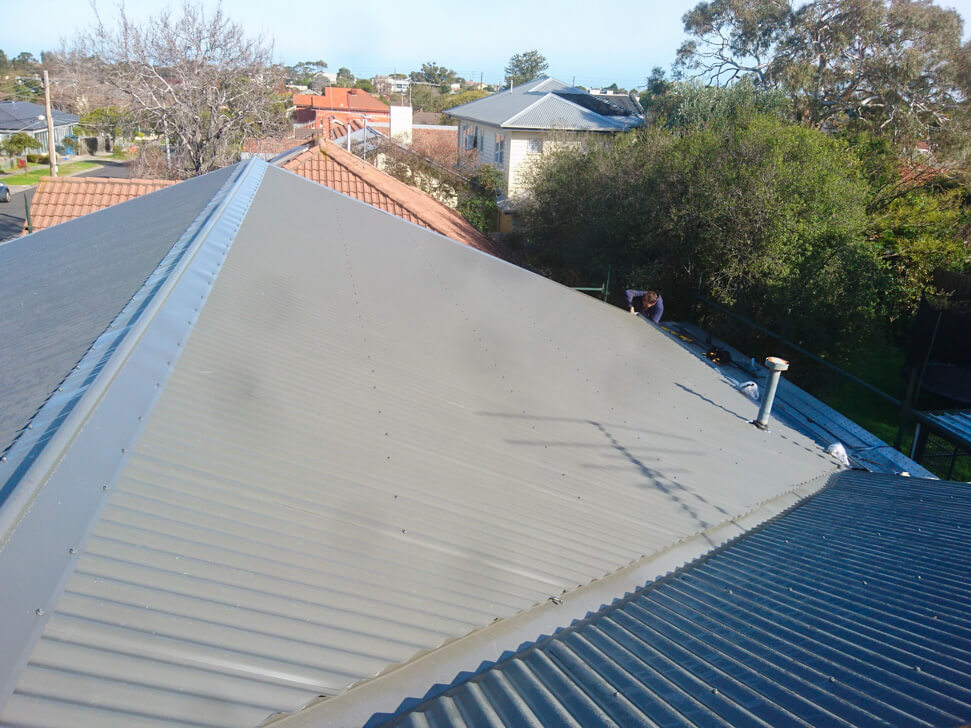 Back right section of new roof in Woodland Grey