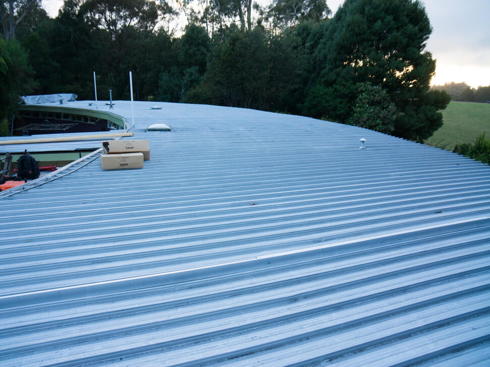 Flat metal roof needs replacement