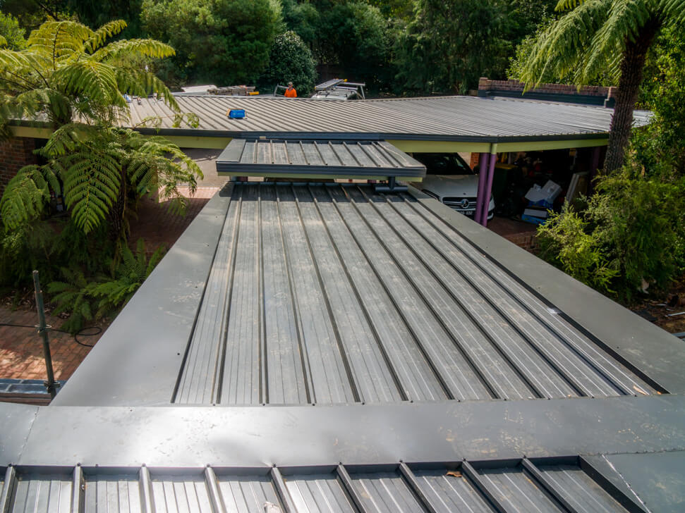 New flat metal roof installation