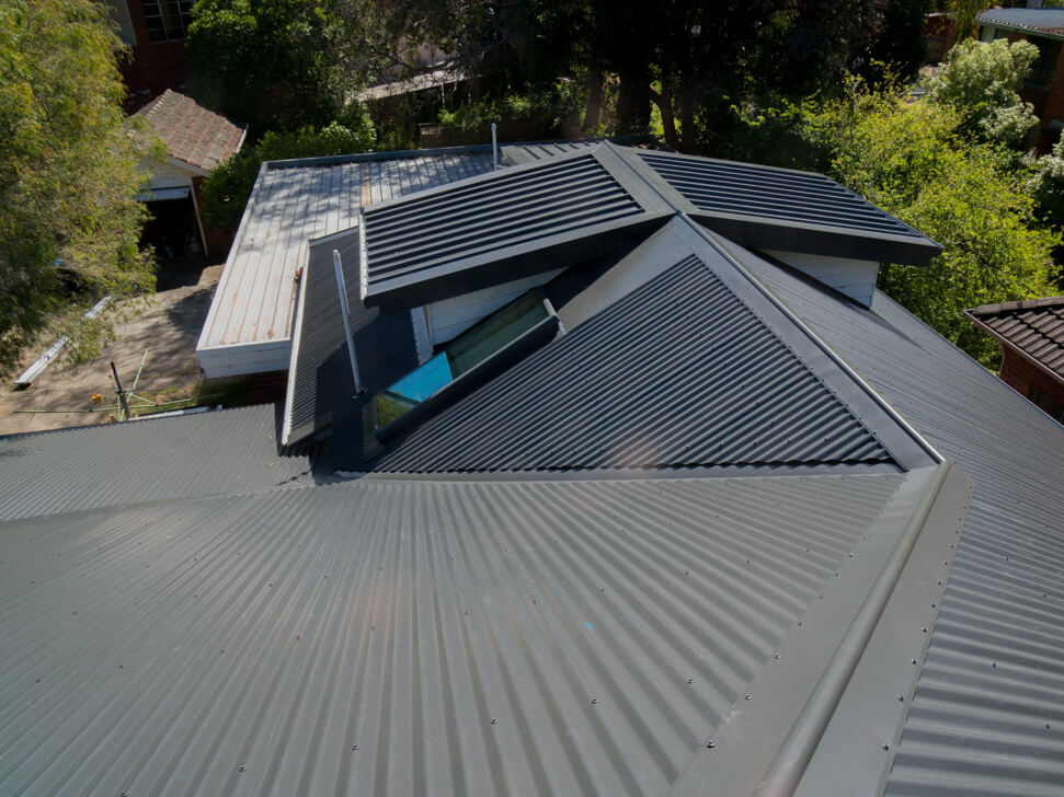 Skylight replacement on a new roof